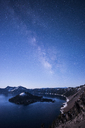 Majestic view of Crater Lake against milky way during dawn - CAVF38753