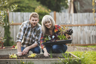 Portrait of couple gardening at backyard - CAVF38927