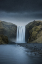 Scenic view of waterfall against cloudy sky - CAVF39011