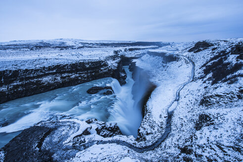 Scenic view of waterfall against sky during winter - CAVF39023