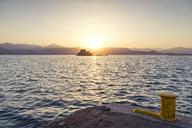 Greece, Peloponnese, Argolis, Nauplia, Argolic Gulf, View to Bourtzi Castle at sunset - MAMF00029
