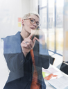 Businesswoman on cell phone in office - UUF13331