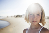 Close-up portrait of girl standing at beach on sunny day - CAVF39349
