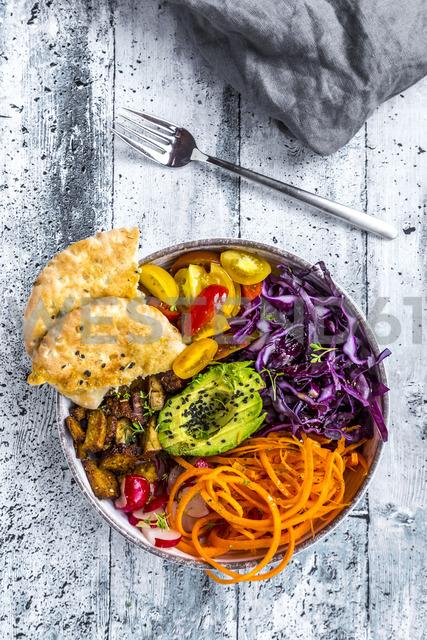 Veggie bowl with tomato, tofu, red cabbage, avocado, carrot, red redish, cress, black sesame and pita bread - SARF03659