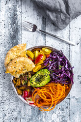 Veggie bowl with tomato, tofu, red cabbage, avocado, carrot, red redish, cress, black sesame and pita bread - SARF03659