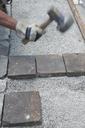 Man paving a way, cobblestones, hammering - CRF02784