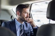 Thoughtful businessman sitting in car - CAVF39725