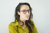 Portrait of young woman wearing glasses - MOEF01024