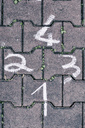 Drawn numbers on cobblestones - MUF01518