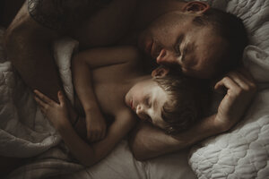 High angle view of father and son sleeping on bed - CAVF40163