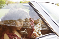 Young couple travelling in car - CAVF41099