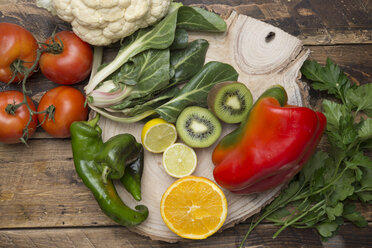 Various fruits and vegetables with vitamin c on wood - SKCF00425