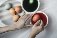 Cropped hands of woman making Easter eggs with dye at home - CAVF41284