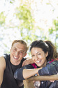 Portrait of happy multi-ethnic couple at outdoor gym - MASF04691