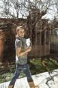 Side view portrait of female architect walking at yard seen through glass window - MASF04805