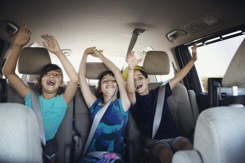 Happy family traveling in car - CAVF41720
