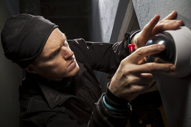High angle view of male technician installing security camera on wall - MASF04867