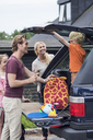 Happy family preparing for road trip - MASF04937