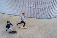 Young couple longboarding, seen from above - STSF01486