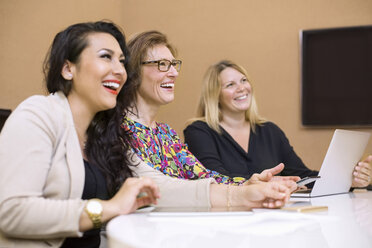 Happy businesswomen in meeting at board room in creative office - MASF04998