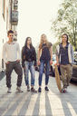 Full length portrait of confident high school students standing on sidewalk - MASF05004
