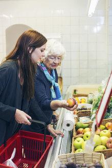 Grandmother and granddaughter shopping fruits at supermarket - MASF05034