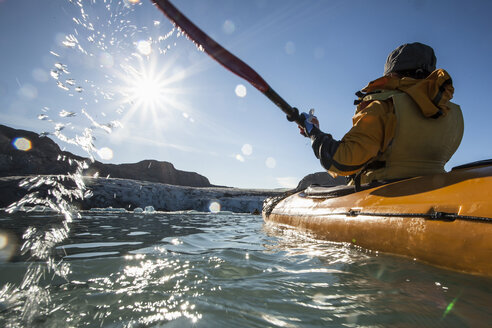 Rear view of mature woman kayaking on sea - MASF05251