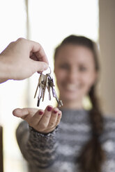 Young woman receiving new home key - MASF05356