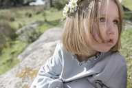 Portrait of blond little girl wearing flowers - KMKF00178