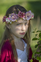 Portrait of daydreaming little girl wearing flowers - SARF03668