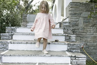 Little girl walking downstairs - KMKF00196