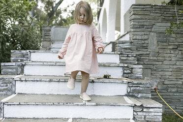 Little girl walking downstairs - KMKF00196