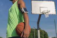 Young basketball player with ball and arm pocket - FMOF00340