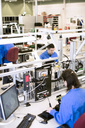 Male and female technicians working in electronics industry - MASF05545