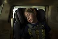 Boy sleeping while traveling in car - CAVF43023