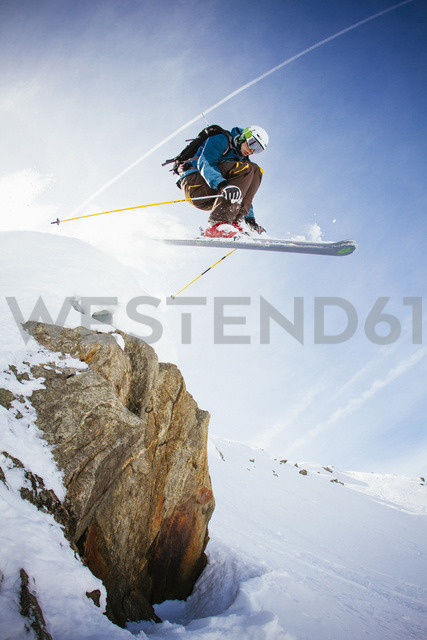Full length of free ride skier in mid air against sky - MASF05673