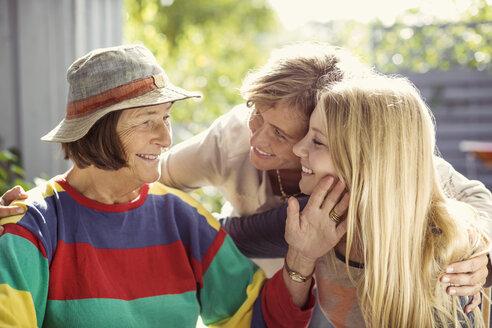 Affectionate three generation females at yard - MASF05745