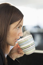 Businesswoman having coffee in office - MASF05787