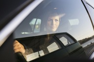 Businesswoman looking through window while driving car - MASF05790
