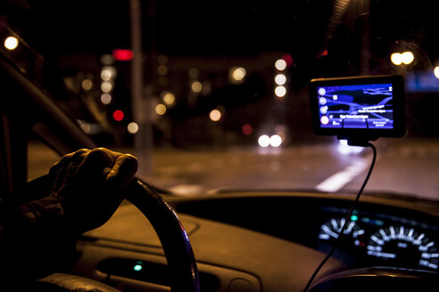 Cropped image of man driving car at night - MASF05856