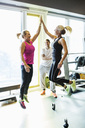 Excited fit women giving high-five at gym - MASF05877