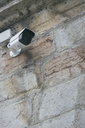 Low angle view of security camera on wall - CAVF43536