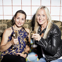 Portrait of happy female friends holding champagne flutes on sofa - MASF06054