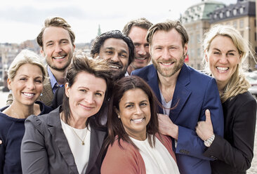 Portrait of happy multi-ethnic business people standing together outdoors - MASF06129