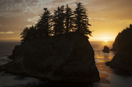 Scenic view of silhouette rock formations and sea against sky during sunset - CAVF44775