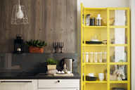 Yellow cabinet by kitchen counter at home - CAVF44847