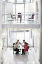 High angle view of business people discussing at desk in office - MASF06300