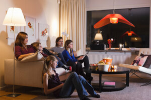 Family watching television together in living room - MASF06450