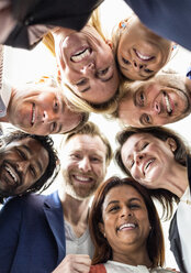Directly below shot of multi-ethnic business people forming huddle - MASF06465