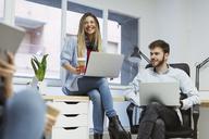 Coworkers in the office having an informal meeting - OCAF00237